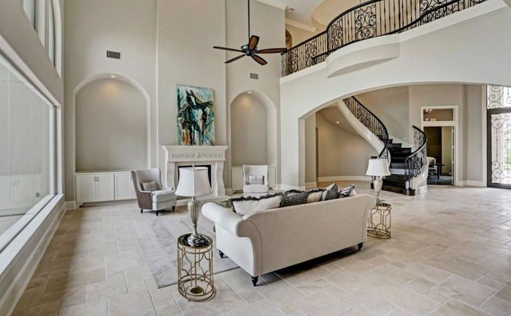 This newly built stone & stucco waterfront home is located at 62 Haven Shore Lane in Sugar Land, Texas and is situated on nearly half an acre of land.