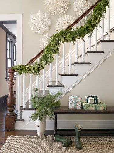 Instead of a single-note pine, this intricate garland incorporates fresh asparagus ferns and evergreen shrubs.: Decor Ideas, Stairs, Staircase, Country Living, Paper Snowflakes, Asparagus Fern, Holidays Decor, House, Christmas Decor