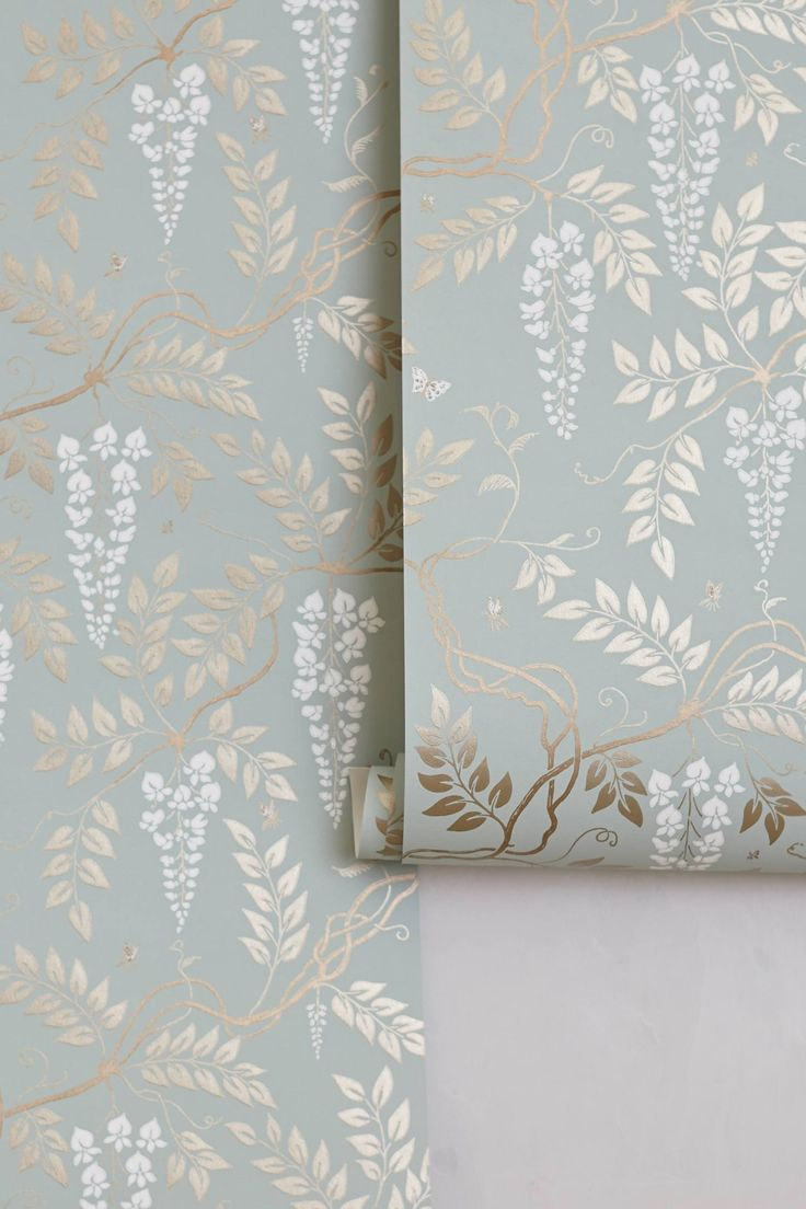 Totally love this vintage style wallpaper from Anthropologie. Soft green, cream and gold wisteria.