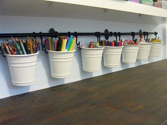 The parent bloggers at Renovation Tracker used a row of Fintorp caddies to house their children's art supplies.