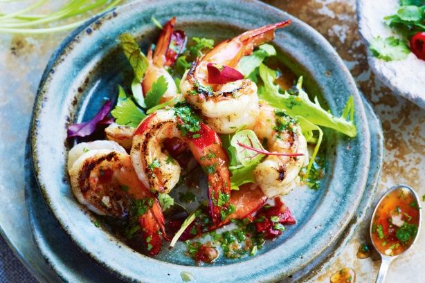 Create a taste sensation with prawns cooked on the barbecue and served with a spicy, Asian-style dressing.