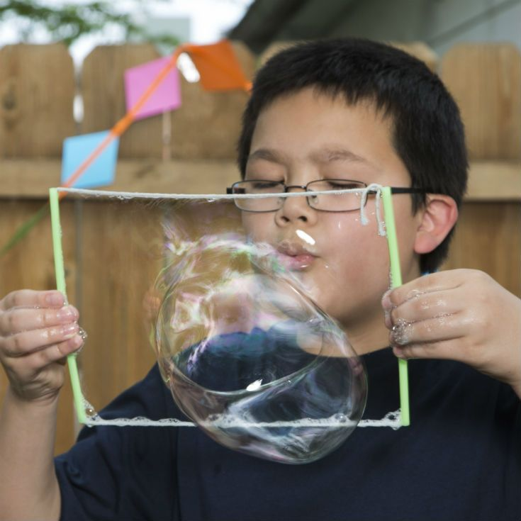 Turn your backyard into a summer science carnival with fun, hands-on experiments from MSI, like these super bouncy bubbles.Science Carnival