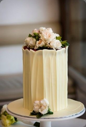 Lovely Cake...i think maybe it's long white chocolate strips going up the sides.. #MirassouDinner