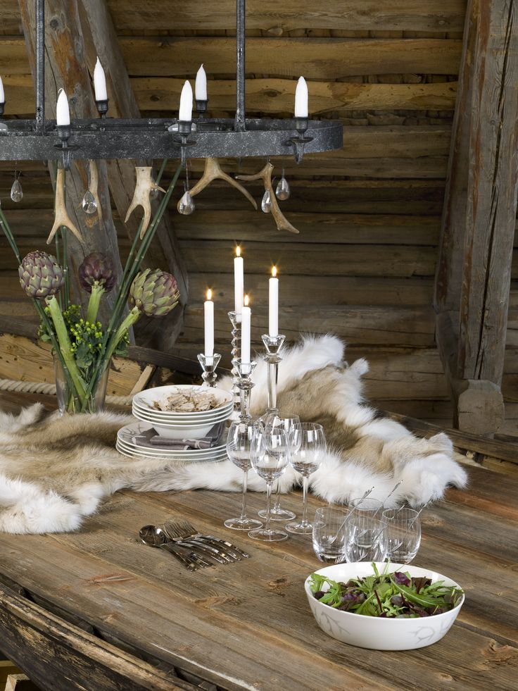 Pentik Shamaani Chandelier |  Handsome dark brown Shamaani (Shaman) chandelier brings mystic Lapland atmosphere to your home. The chandelier is made of dark brown painted metal, and reindeer antlers and crystals have been hanged onto it.
