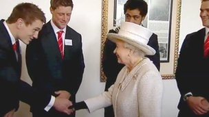 Wales' Grand Slam-winning rugby squad squad were introduced to the Queen