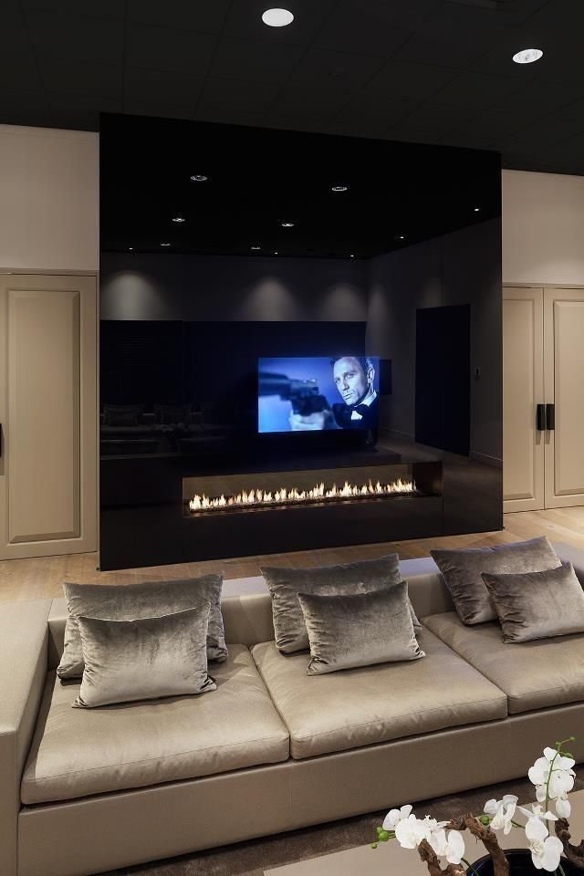 TV + Fireplace + Champagne Colored Pillows…so chic