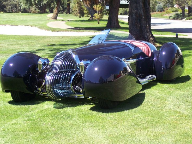 Blastolene B702 V-12. Randy Grubb design recalling 1930 Delahaye. A hand formed aluminum body is finished in a dark blue with a Maroon leather interior. A GMC 702 cu.in. V12 and and Allison 4 speed automatic for power. Also features a glass grille and hand blown taillights. This project took 4500 hours over a 2.5 year period to complete.