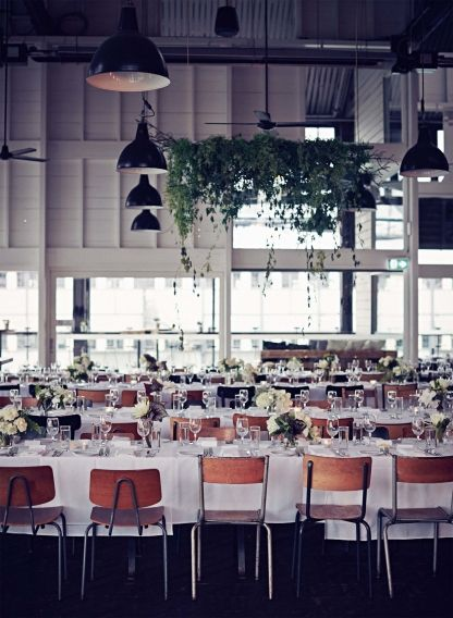 Inside Vogue fashion editor and market director Philippa Moroney's harbourside wedding: The Sydney Theatre Company's Bar at the End of the Wharf, which the couple picked because of its vintage-industrial character and Sydney Harbour views.