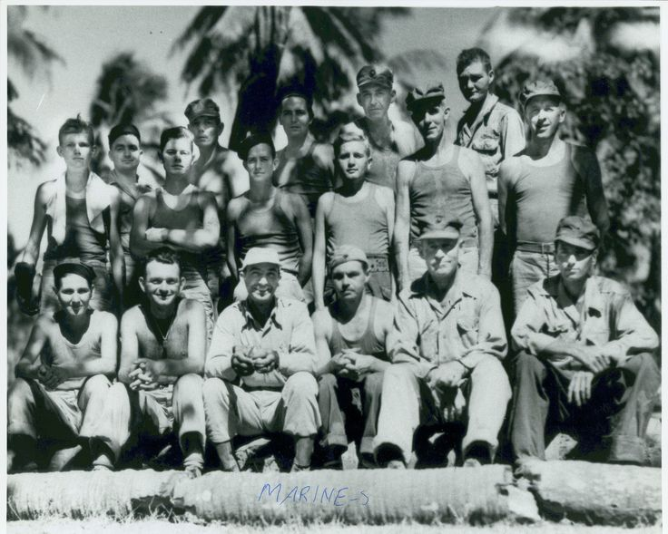 """Liberated Marines from Cabanatuan, March 1945   """"""""Liberated from Cabanatuan-Proudly wearing Marine uniforms for the first time in three years, 16 US Marines liberated from the Japanese prison camp at Cabanatuan, near Manila, pose with the commander of the picked Army Rangers who rescued them.""""  The Marines in the photograph include Front row, (left to right): Edward L. Berry; Harry W. Pinto; Henry A. Mucci; Fred S. Vinton; John B. Kelly; Chester J. E..."""