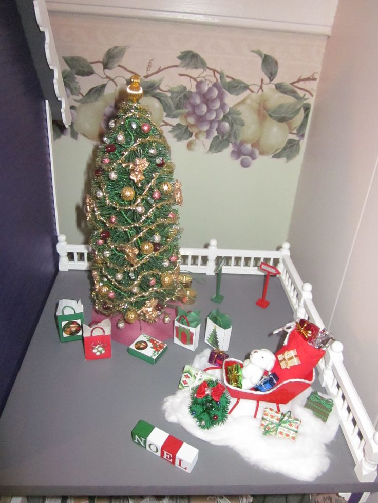 The red sleigh came from Michaels; I made the display for it including Santa's toy bag.  I made the gifts and the NOEL sign, teddy bear, wreaths and signs came from Michaels.
