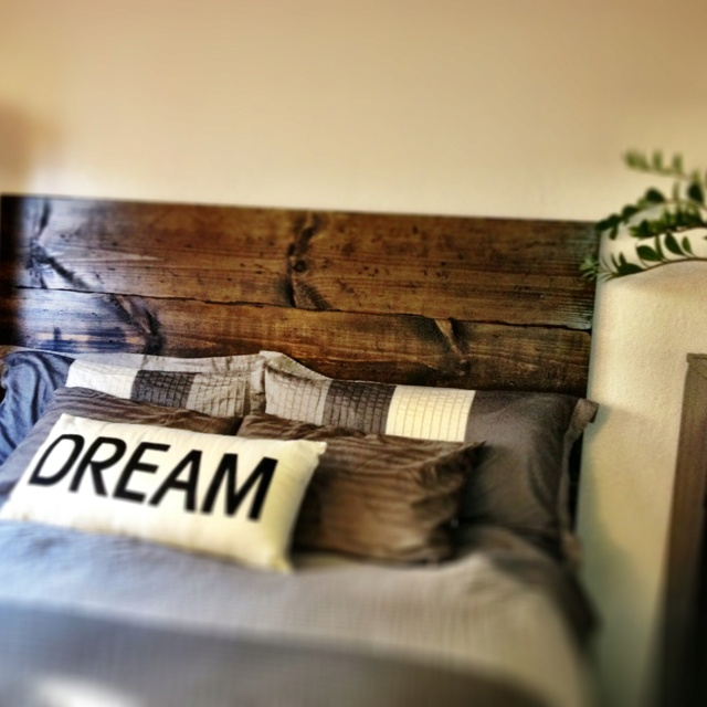 3 six foot 1x12s, stained, mounted to wall. Easy DIY headboard. $35!