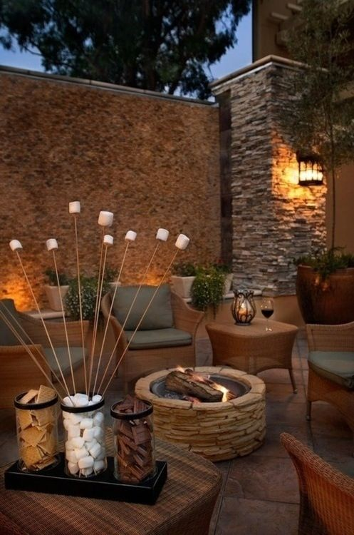 Outdoor patio with stone fire pit. Love how the s'more fixins' are presented!!!
