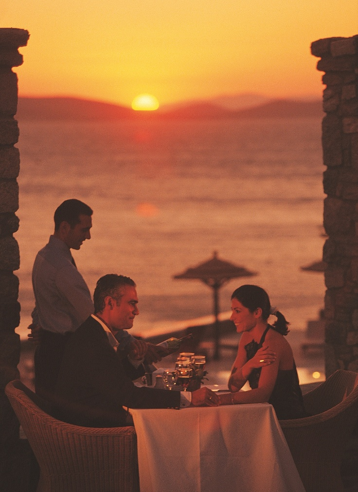Experience a candlelight dinner at the Mykonos Grand hotel with inspiring Greek cuisine and memorable views. Tenderly holding hands, still in love,  smile with the sweet melancholy of fulfillment at the thought of those days gone by …  of our honeymoon.