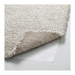 The dense, thick pile dampens sound and provides a soft surface to walk on. Durable, stain resistant and easy to care for since the rug is made of synthetic fibers. The high pile makes it easy to join several rugs, without a visible seam.