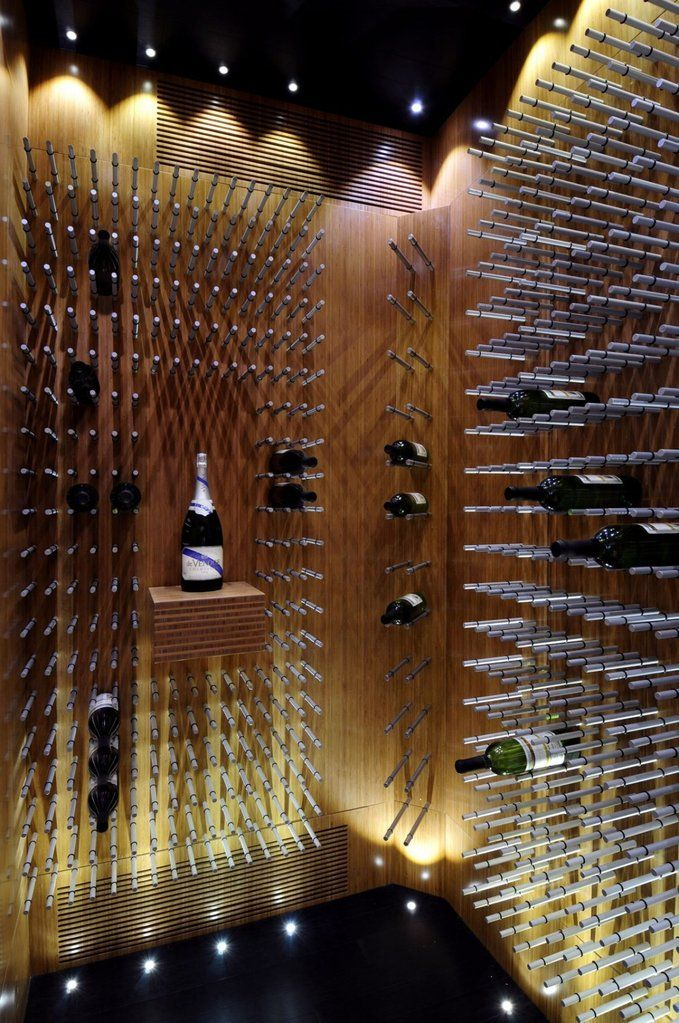 910 Project by Smith Designs - A stunning fusion of form and function. This space over-looks Victoria's harbour in beautiful, British Columbia, Canada. Photo by Russ Heinl  It is especially rare for an entire space to be built completely custom. Yet, this eye-catching wine cellar display has been built with quality in mind. Each detail, from the wall panels to the metal wine pegs to the twinkling LED lights has been carefully crafted to fit this space --- and the wine collector's n...