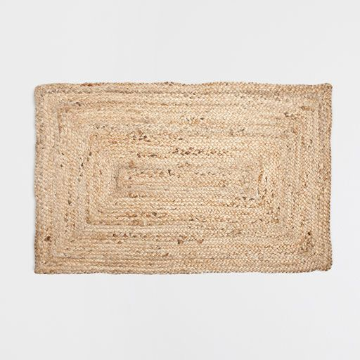 Image of the product NATURAL-COLOURED FRAMED JUTE MAT
