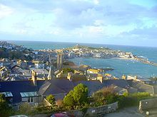 St. Ives harbour and the sea beyond.  Lawrence Stern's cottage (writes Rosamunde Pilcher) stood where Thomas Millie Dow's large house had stood, above St. Ives and the bay, and surrounded by a beautiful walled garden.