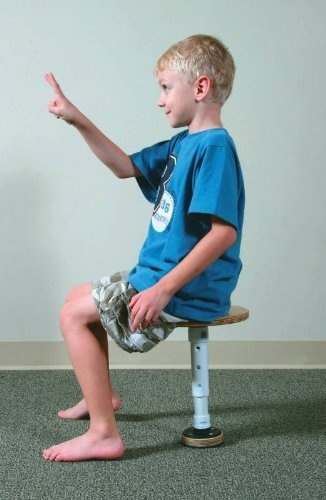 """Activity to Develop Vestibular Integration. """"A T-stool helps a child improve his sense of balance, his posture, and his ability to pay attention."""" -Carol Stock Kranowitz in The Out of Sync Child"""