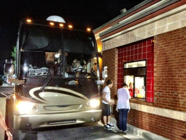 one directions tour bus at a mcdonalds drive through after ...