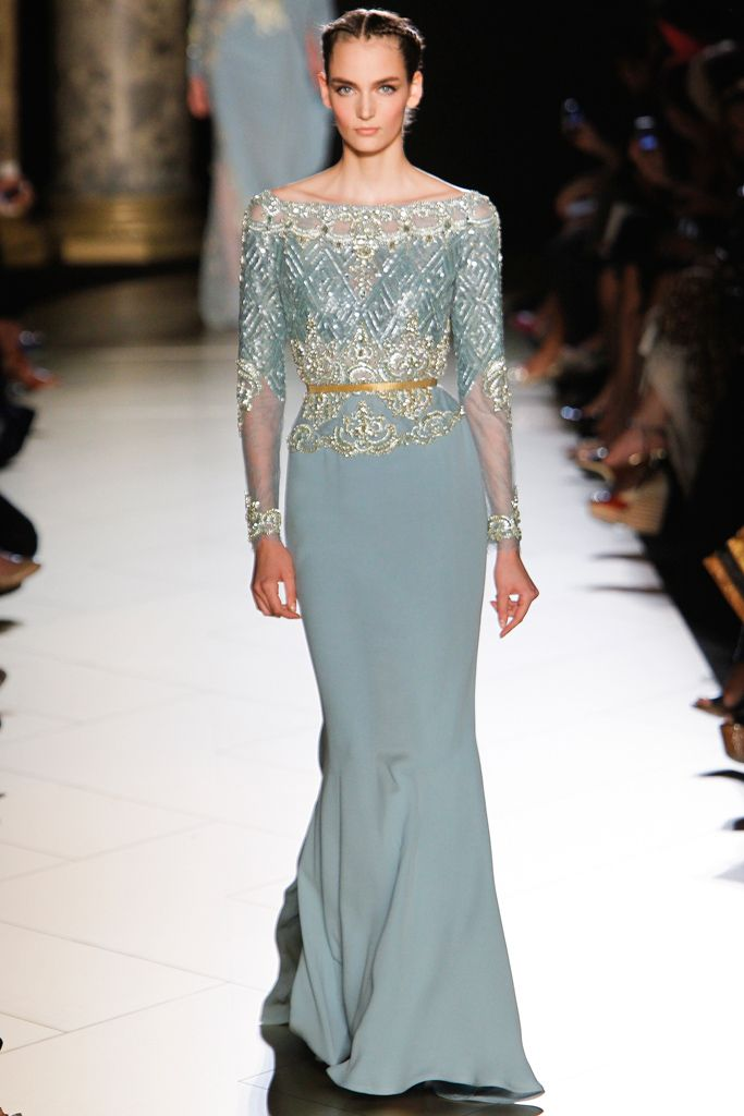 Elie Saab F 2012: Beautiful pale blue dress with silver embellishments with sheer sleeves. I like the Ice Queen inspired dress! All she is missing is a crown!