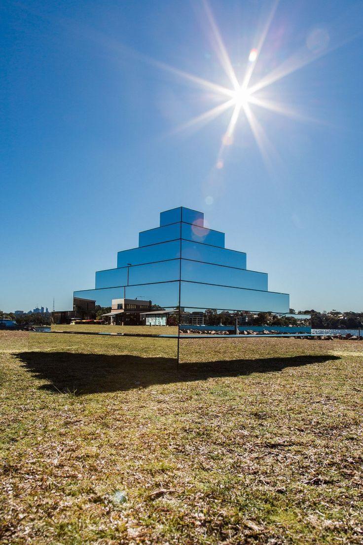 Mirrored Ziggurat sculpture (artist Shirin Abedinirad) - a pyramid of mirrors resting near a bay in Sydney, Australia as part of the Underbelly Arts Festival.