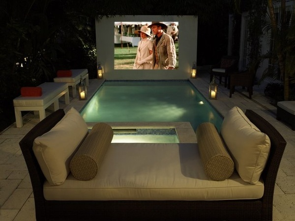 A gorgeous exterior space with a hot tub, pool and outdoor movie screen! Very cozy, elegant, and definitely the spot for a good time lasting long into the night! | Caption by Jenn Brown