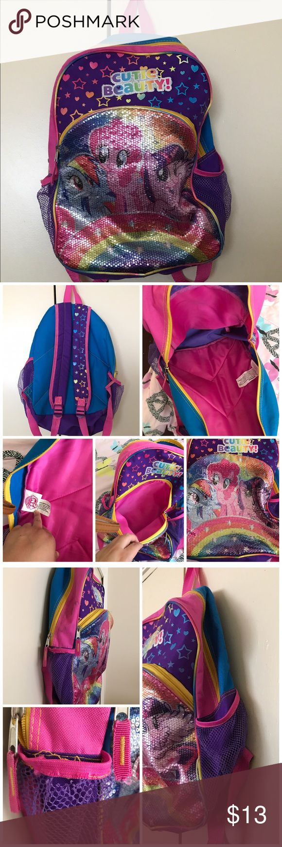 My little pony backpack Gently used in good condition. It's a regular size my little pony backpack. Very clean inside. Only one side it's a little dirty and by washing it might come of and on that same side it has a loose flaw that can be place back by sewing it or by hot glue gun. No trades or Pp thanks My Little Pony Accessories Bags