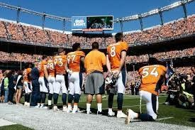Denver Broncos kneel during national anthem in protest of police brutality and in protest of Donald Trump. (September 24, 2017)