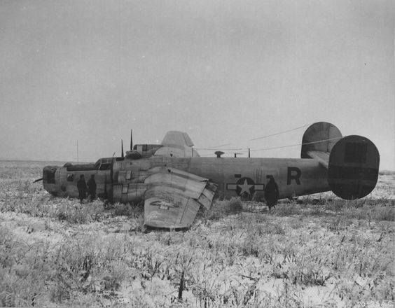 """US bomber B-24 Liberator of USAAF 465th Bomber Group after crash landing in the Poltava airfield Ukraine Jan 4 1945. Poltava was the main airfield of Operation Frantic a USAAF """"shuttle bombing"""" operation sending bombers to hit German targets and then land in locations in the USSR. This system extended the range of US bombing significantly. The operation though fizzled out because of Russian underlying hostility and refusal to protect the Frantic bases adequately."""