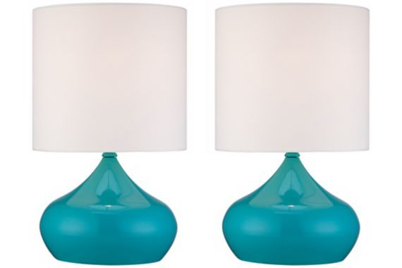 Cool blue finish steel droplet bases create an engaging look for this set of two contemporary accent lamps.
