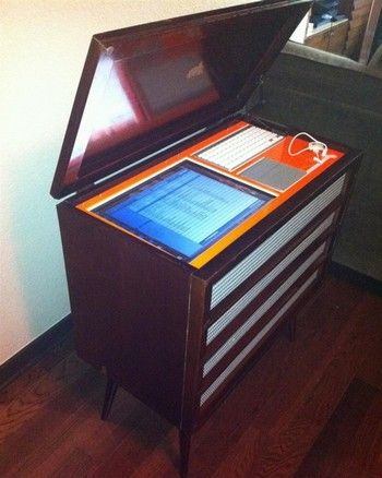 This handsome DIY project takes an old stereo cabinet, guts and refinishes it, and packs it full of new speakers, electronics, and a monitor with keyboard and touchpad interface.