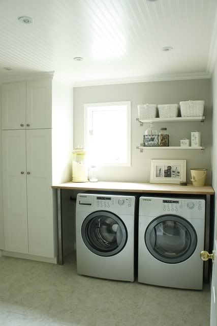 This is exactly how my laudry room is designed...except I have an empty space next to my washer & dryer...wonder if my husband could build cabinet space like that :)