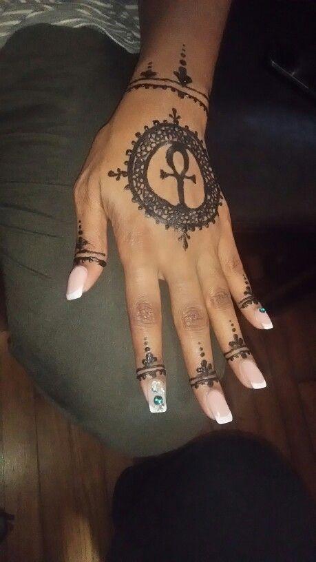 The ankh is a most sacred symbol. Henna allows you to express all your desires. #HENNAFYD Fundi Fe 616-322-3166 #Henna #BlackHenna #HennaHead #FundiFe