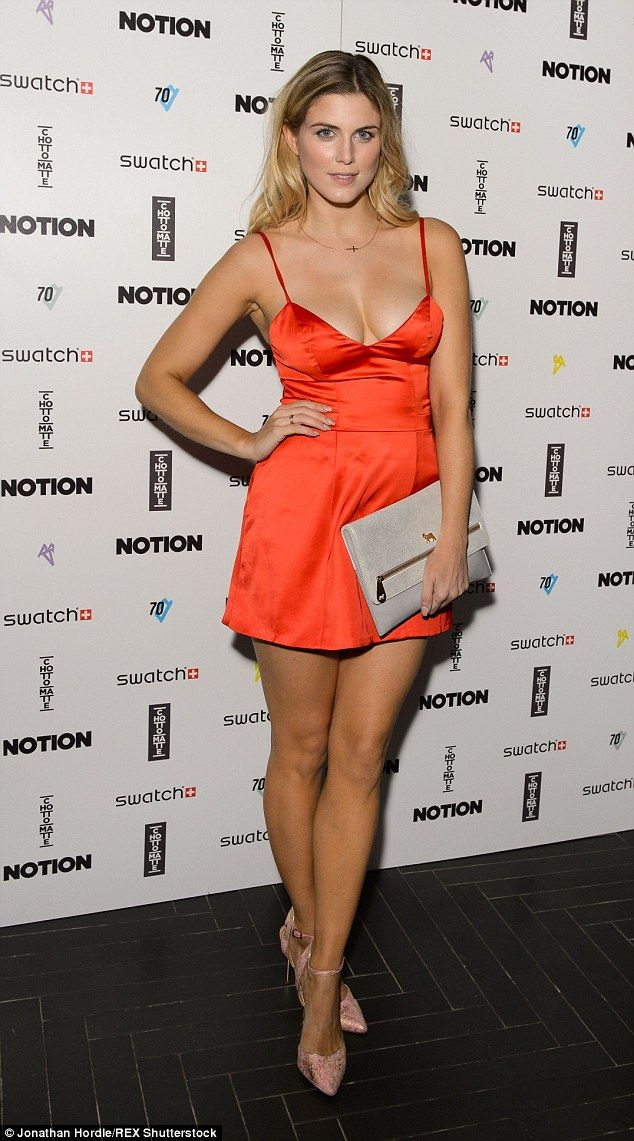 Another daring look: Former Made In Chelsea star Ashley James chose a revealing orange mini dress