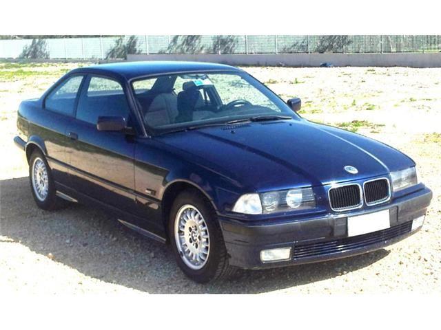 bmw 320 coupe blu - con lei