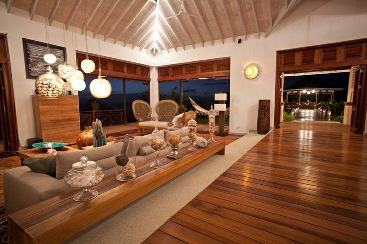 A stunning villa in the caribbean by Nomade Architettura http://www.nomadearchitettura.com/#all  teak floor, local briks, hanging metal lighting by zenza lighting