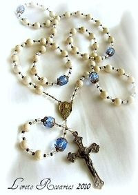 Baby's First Rosary. Choose from blue, pink or clear Our Father beads.