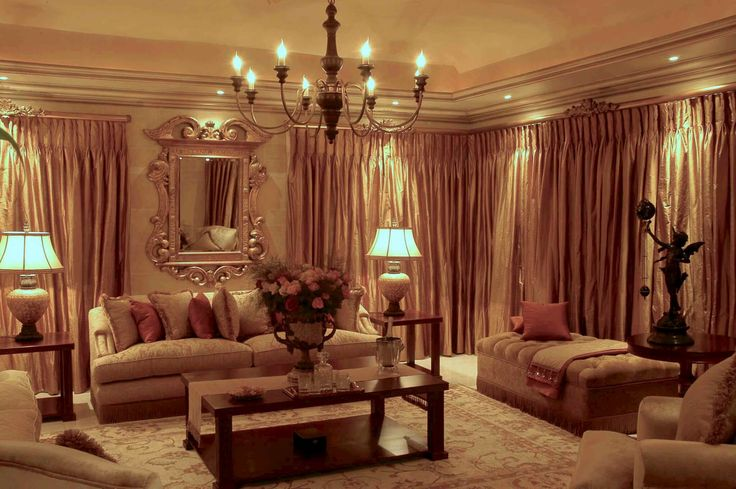A contemporary home in Johannesburg, inspired by Classical Italian interior design and decoration. Sumptuous use of rich fabrics. Creative paint techniques. Impressive chandeliers. Elegant lounge.