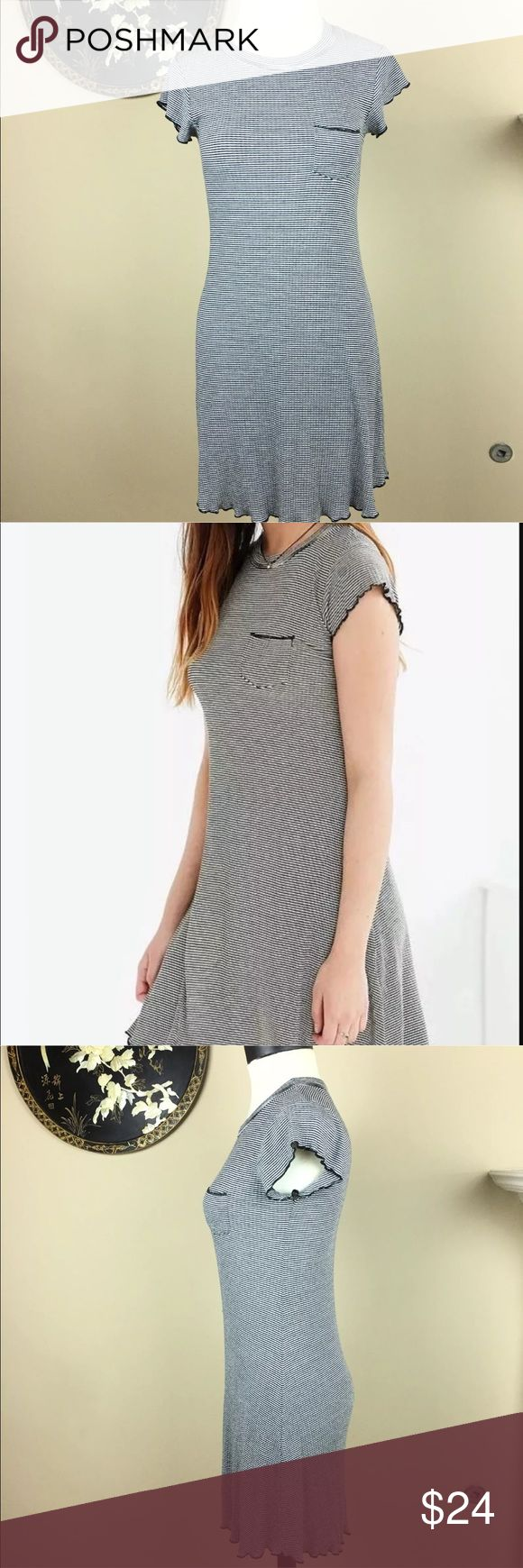 BDG Urban Outfitters Womens T-Shirt Dress  M BDG Urban Outfitters Womens T Shirt Dress Size M Ribbed Black White Stripped  Cute up your casual look with this cap-sleeve camper dress from UO-original label BDG. Stretchy ribbed knit cut close to the body with a flared bottom for a classically femme fit. Detailed with a banded crewneck, chest pocket, and lettuce edges all over.   THINGS TO KNOW:  - Cotton, spandex  - Machine wash BDG Dresses