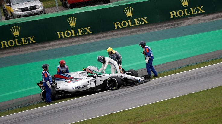 Marshals recover the car of Lance Stroll Williams FW40 after stopping on track in FP3 at Interlagos, São Paulo, Brazil - Saturday 11 November 2017
