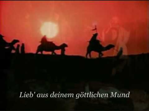 Stille Nacht, Heilige Nacht - Nana Mouskouri.  My father used to be able to sing this in German (learned from his first wife, who was of German heritage.)
