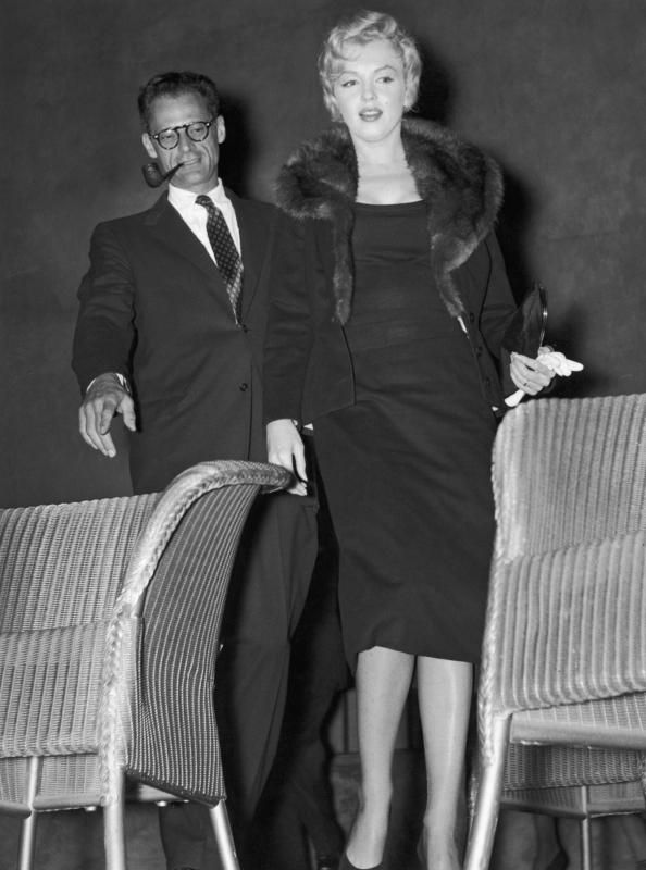 A black wool tailored jacket. The fitted jacket is lined with pale pink and ivory striped silk. Monroe wore the jacket with a fur lined collar while attending a meeting to launch the New Watergate Club in London with Arthur Miller on September 10, 1956. The unfinished collar indicates that it was originally lined with fur.