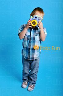 Kid taking photo with toy camera