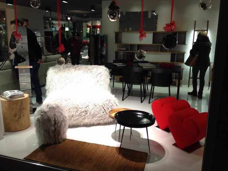 white and #red for #Iliving #Christmas! White as #Chummy #Fuzzy #armchair and #footstool and red as our #Love #seating . In the back #Ptolomeo #book #case #polished #stainless #steel. #Iliving #store #Dolo #Venice #youropinionworld