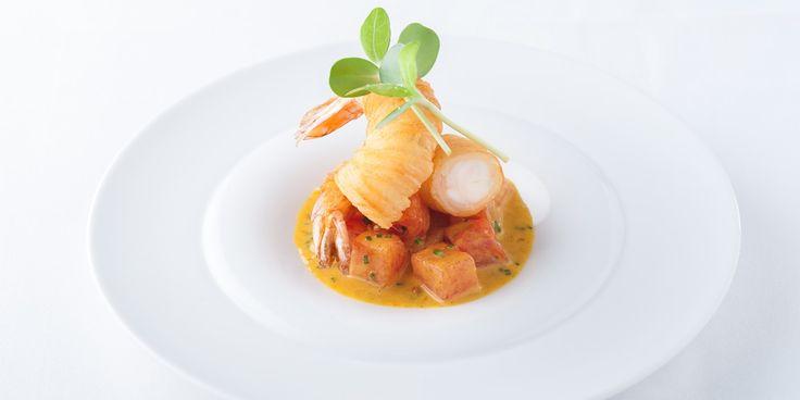 A delicious prawn curry recipe featuring compressed watermelon and spiralized potato by Michelin starred chef Simon Hulstone