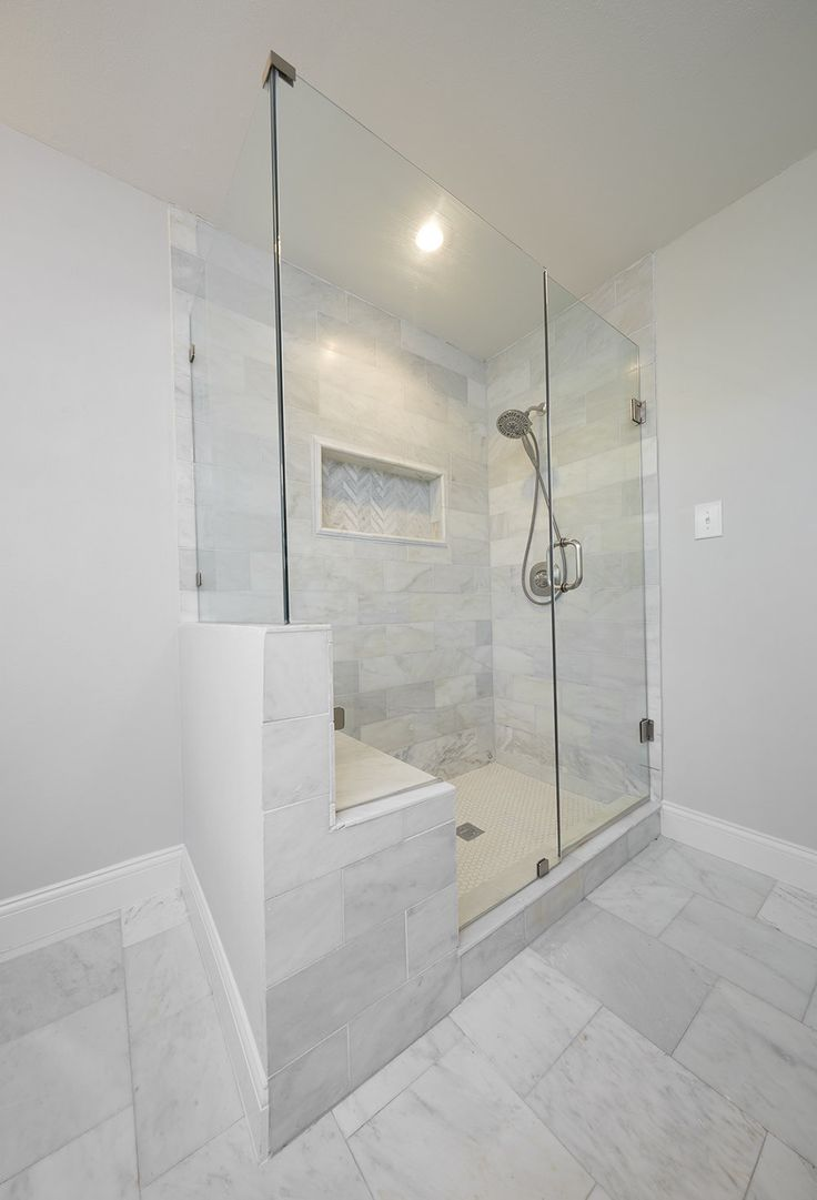 love this extra large white marble master shower with built in seat and frameless glass bathroom