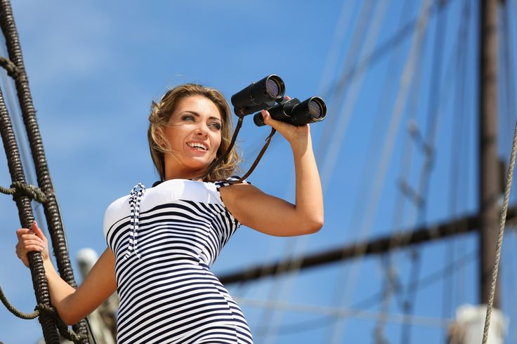 Girl with binoculars standing on the ship, and looks into the di by Elena  Sikorskaya on 500px