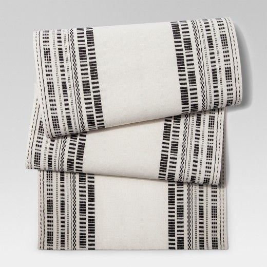 This 100% cotton Woven Table Runner from Project 62™ keeps a neutral cream and gray color palette, which makes it the perfect background for experiments in colorful decor. It would also complement any simple tablescape, with its intricate pattern formed from many tiny dots and dashes. Machine washable, this runner only appears high maintenance.<br><br>1962 was a big year. Modernist design hit its peak and moved into homes across the country. And in Minnesota, Target was b...