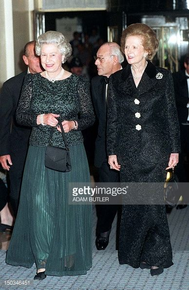 16 OCTOBER 1995  Britain's Queen Elizabeth II (L) and former British Prime Minister Thatcher arrive at Claridge's in London for a dinner to celebrate the former Prime Minister's 70th birthday.