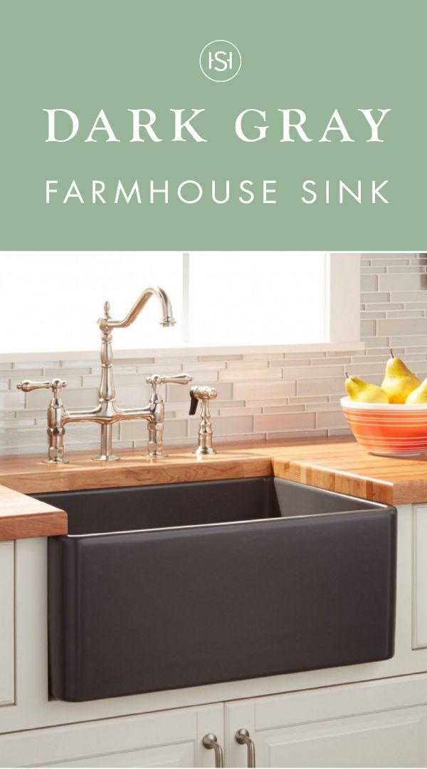"This 20"" Reinhard Fireclay Farmhouse Sink in dark gray isn't just any old kitchen sink. This piece makes a statement—while still complementing your traditional cabinetry, silver faucet, and sophisticated design elements of your cooking area."